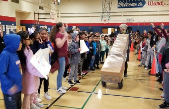 BJ Ward Students Welcome a Donation from Enchanted Backpack